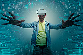 man with outstretched arms wearing virtual reality glasses