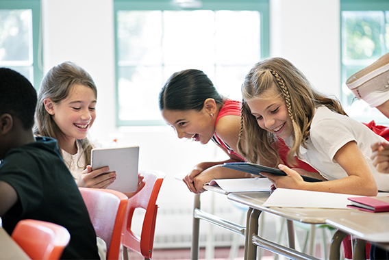 Happy students chatting in class