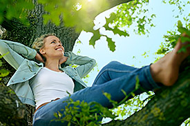 Happy woman relaxes in nature