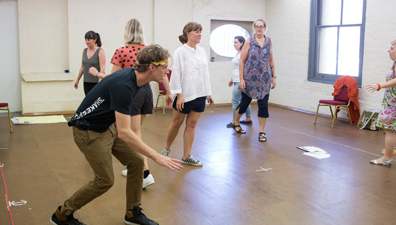 Teachers performing activity at Regional Teacher Mentorship in Sydney at Bell Shakespeare performance space