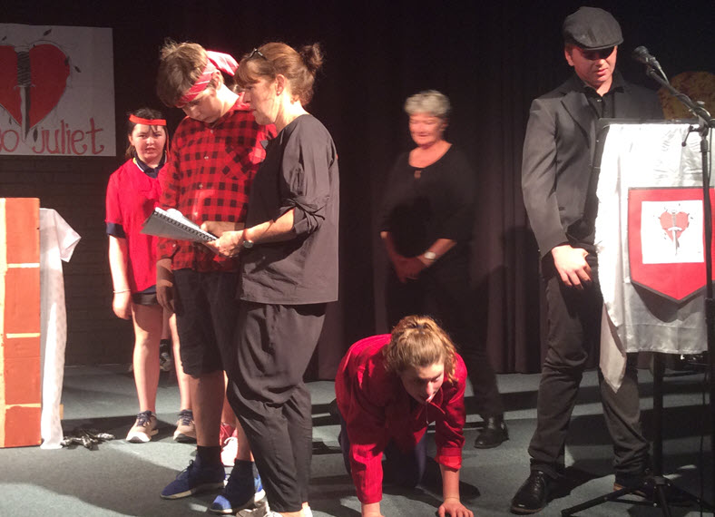 Students with disabilities performing Shakespeare play at school with the help of their teacher