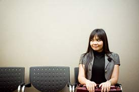 Woman sitting, waiting to be called into an interview for her first teaching job