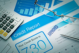credit report document beside calculator