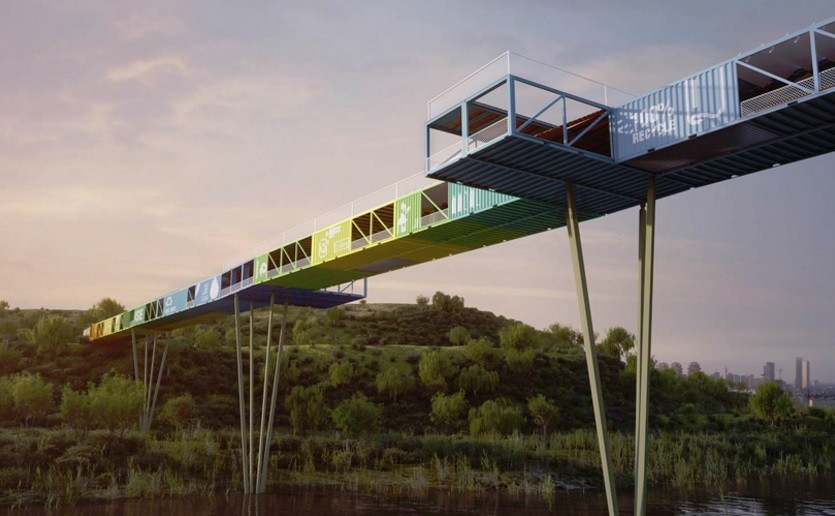 Colourful bridge crossing a river, built with old cargo containers