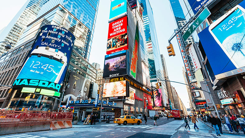 Buildings with bright coloured advertisements in New York's Times Square
