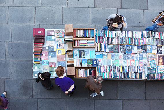 People browsing through a second hand book stall